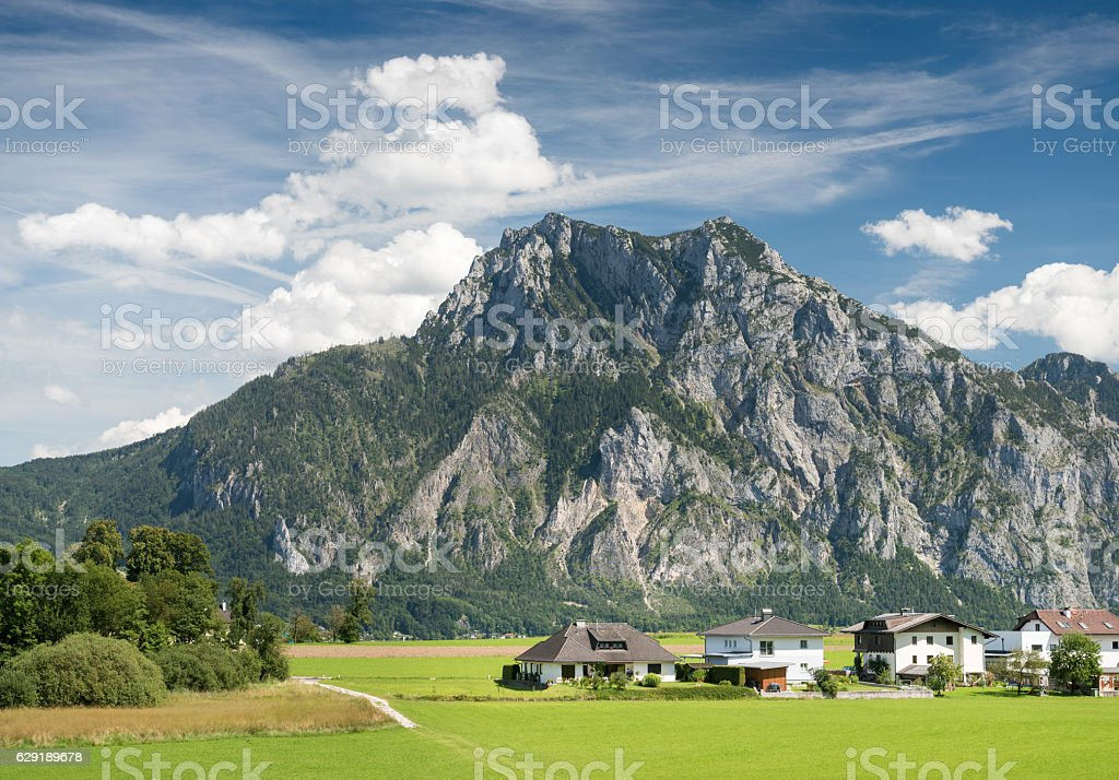 Houses in front of the famous Mountain Traunstein, Traunsee, Austria stock photo