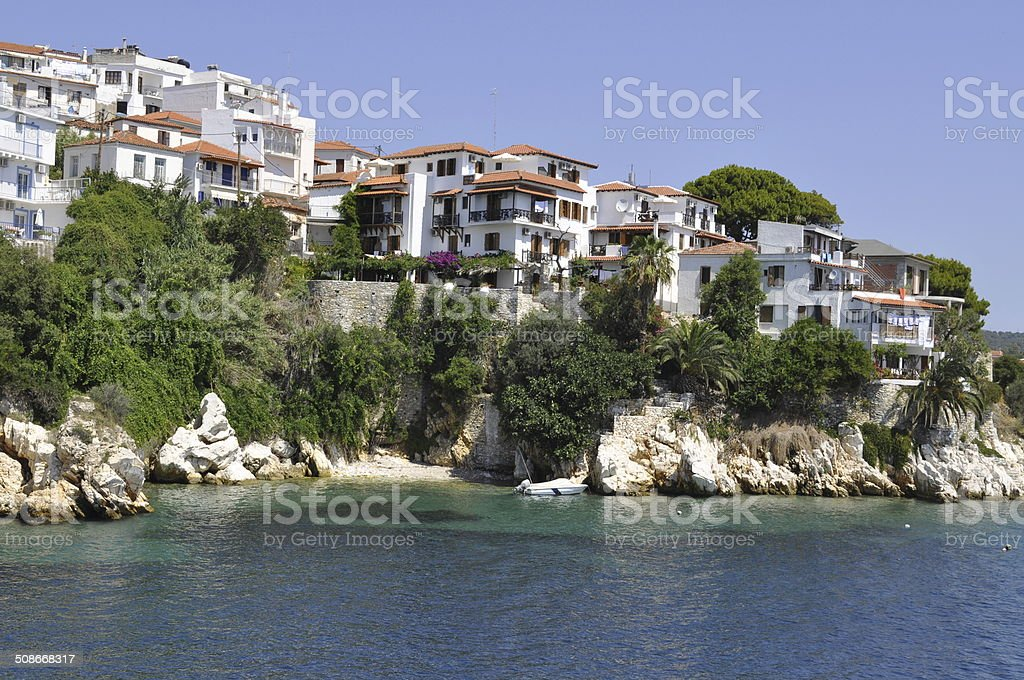 Houses in Skiathos, Greece, rocks and sea royalty-free stock photo