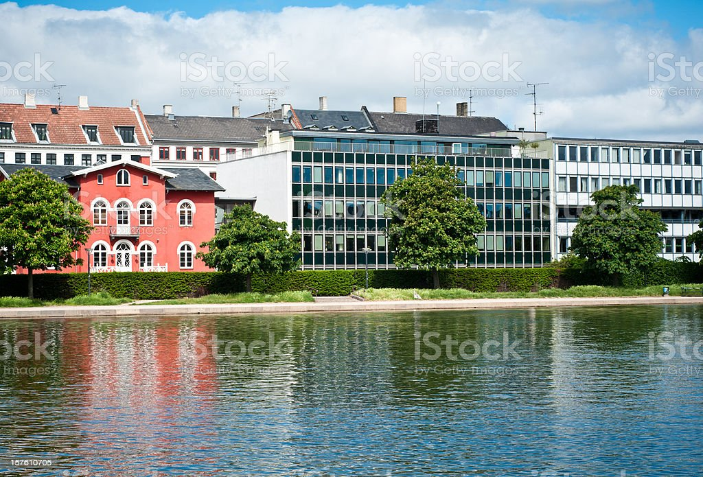 Houses mirroring in a water channel of Copenhagen, Denmark stock photo