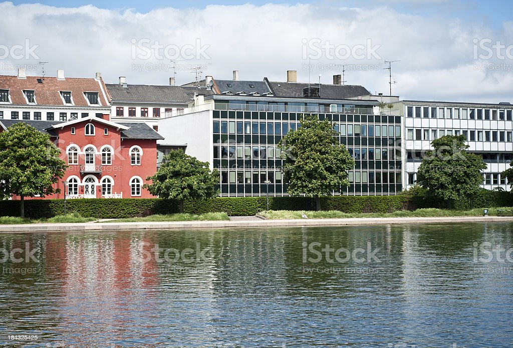 'Houses mirroring in a water channel of Copenhagen, Denmark' stock photo