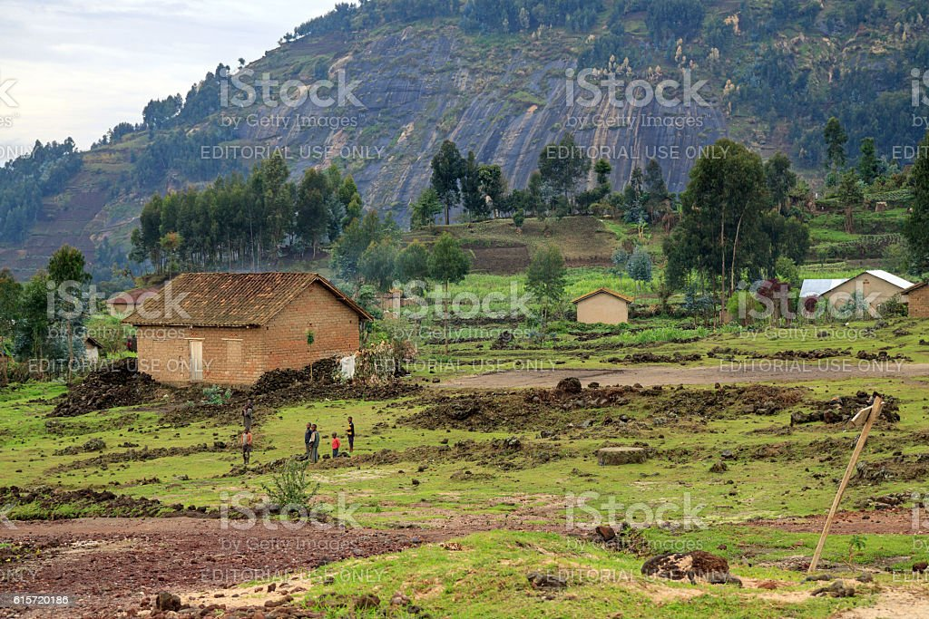 Houses near an eroded hillside in Rwanda stock photo