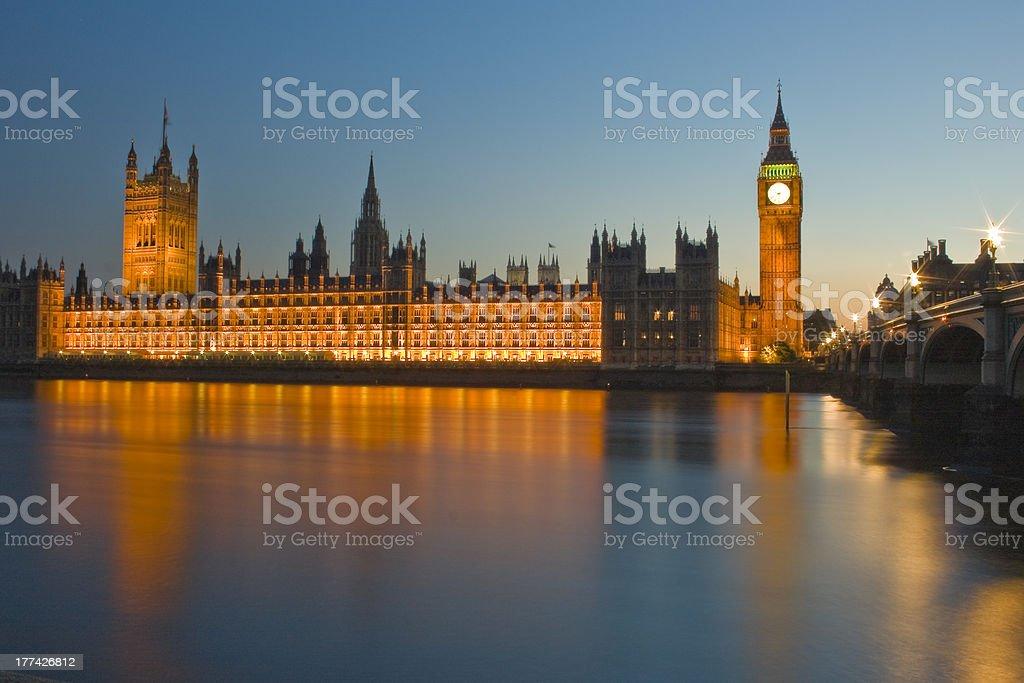 Houses of Parliament illuminated at night stock photo