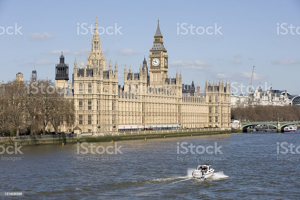 Houses of Parliament with boat on the River Thames royalty-free stock photo
