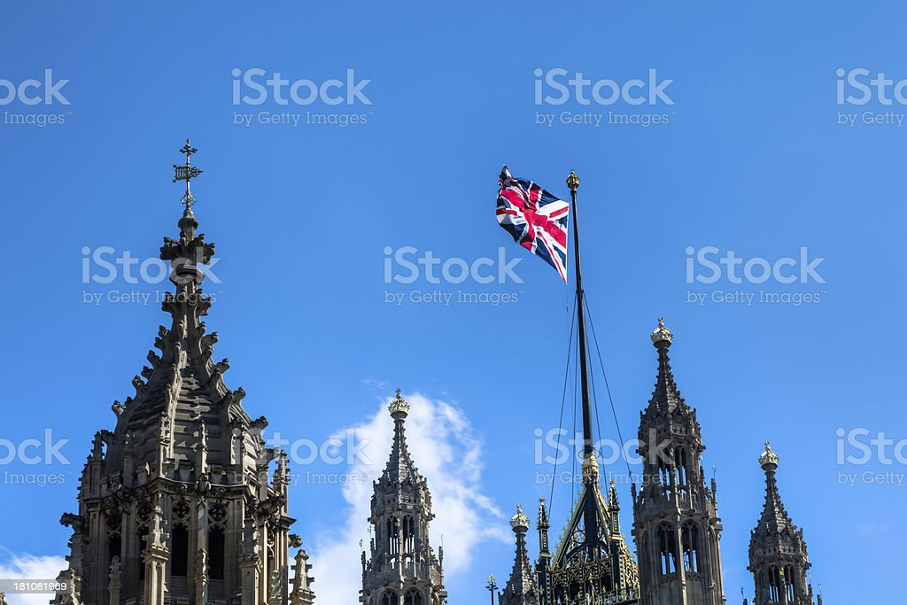 Houses of Parliament with British Flag Blowing in Breeze royalty-free stock photo