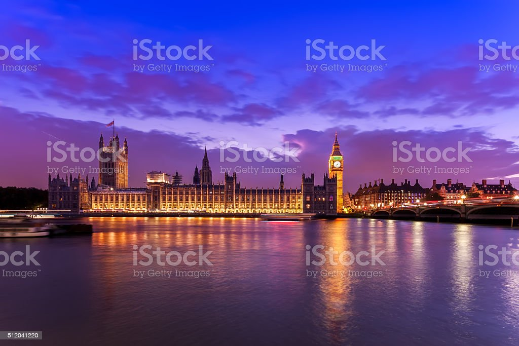 Houses of Parliament with dramatic sky at night, London, UK stock photo