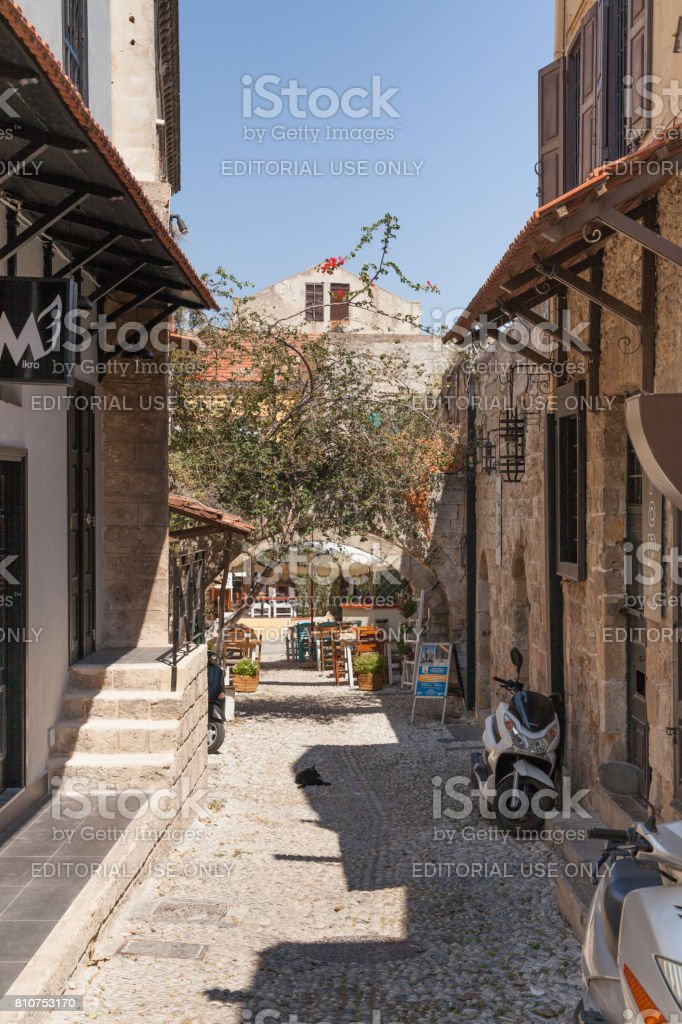 Houses of the locals and narrow streets in the city center in the Old Town of the capital of the island of Rhodes. Typical Greek style and building. stock photo