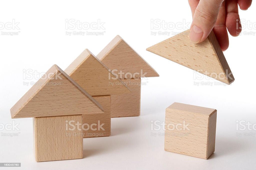 Houses of wood block made by hand on white background royalty-free stock photo