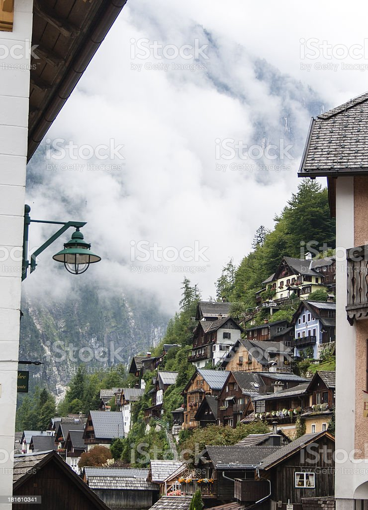 houses on an Hill by Hallstatt, fog in the background royalty-free stock photo