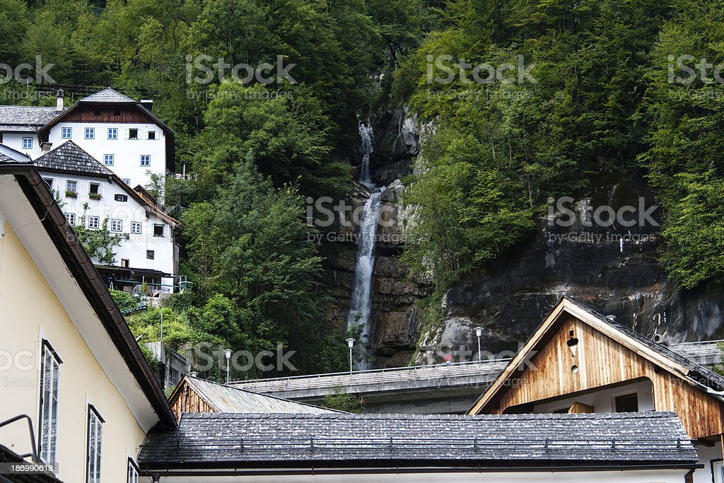 houses on an Hill in Hallstatt with a waterfall royalty-free stock photo