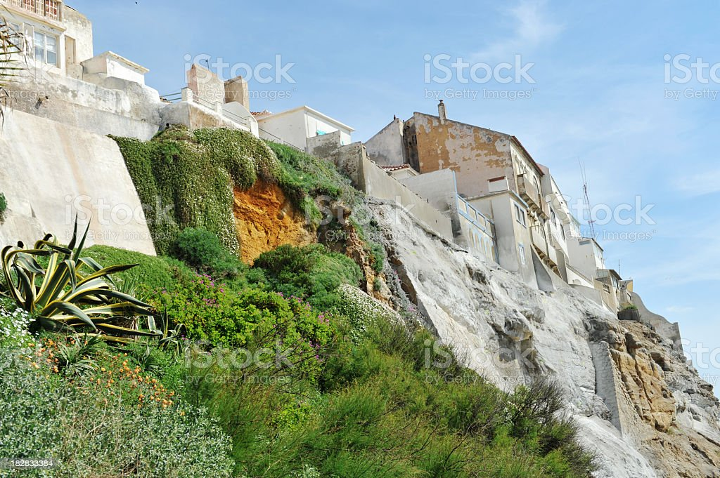 Houses on the edge of a cliff stock photo