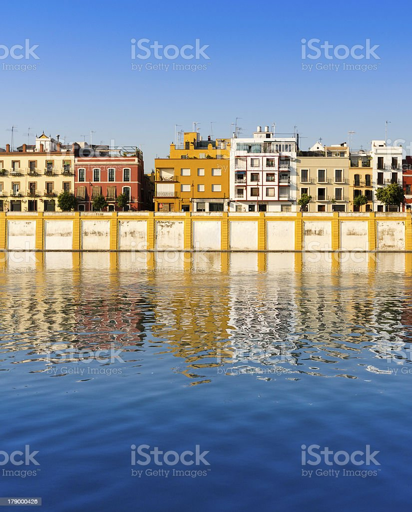 Houses on the shore of Guadalquivir River in Seville royalty-free stock photo