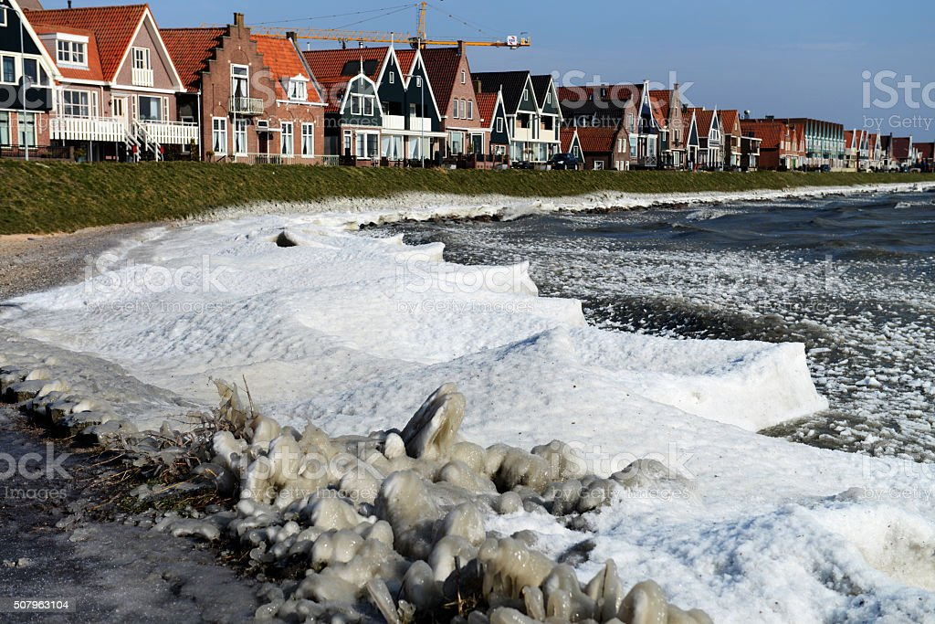 Houses on the waterfront with drifting ice in Volendam stock photo