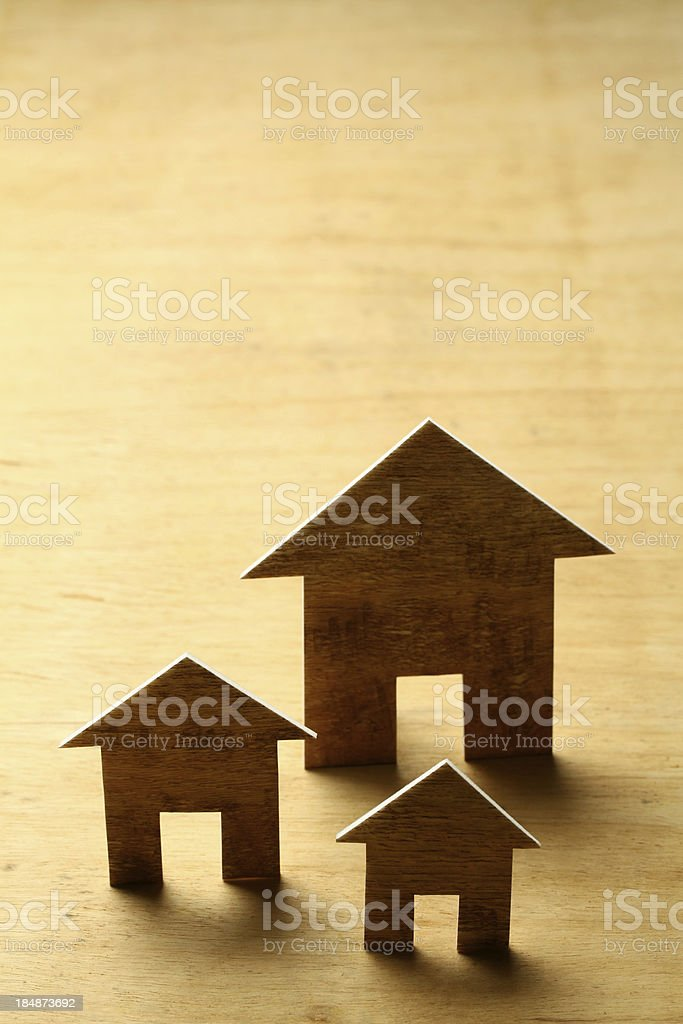 Houses on wooden background royalty-free stock photo