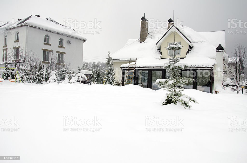 houses under snow in winter stock photo