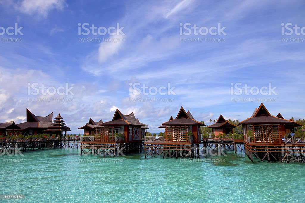 Houses upon stilts in water village on Mabul Island Malaysia stock photo