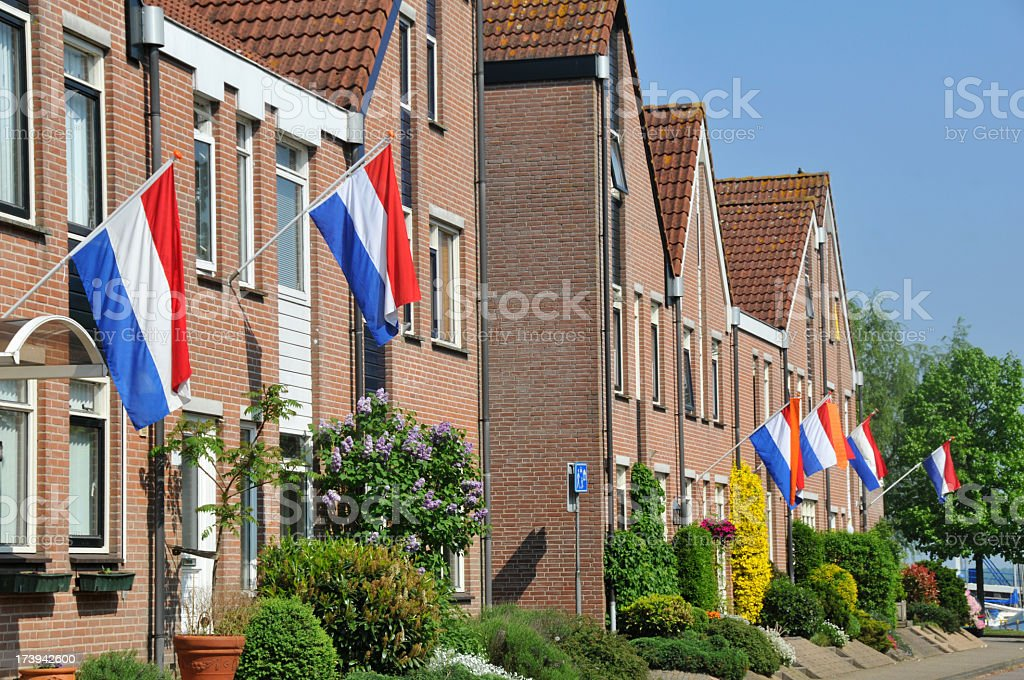 Houses with Dutch flags on sunny day stock photo