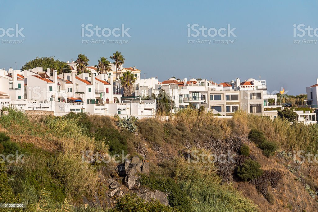 Houses with sea view on the coast in Sines, Portugal stock photo