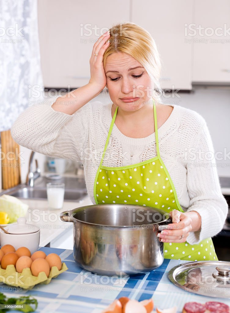 Housewife and spoiled food stock photo