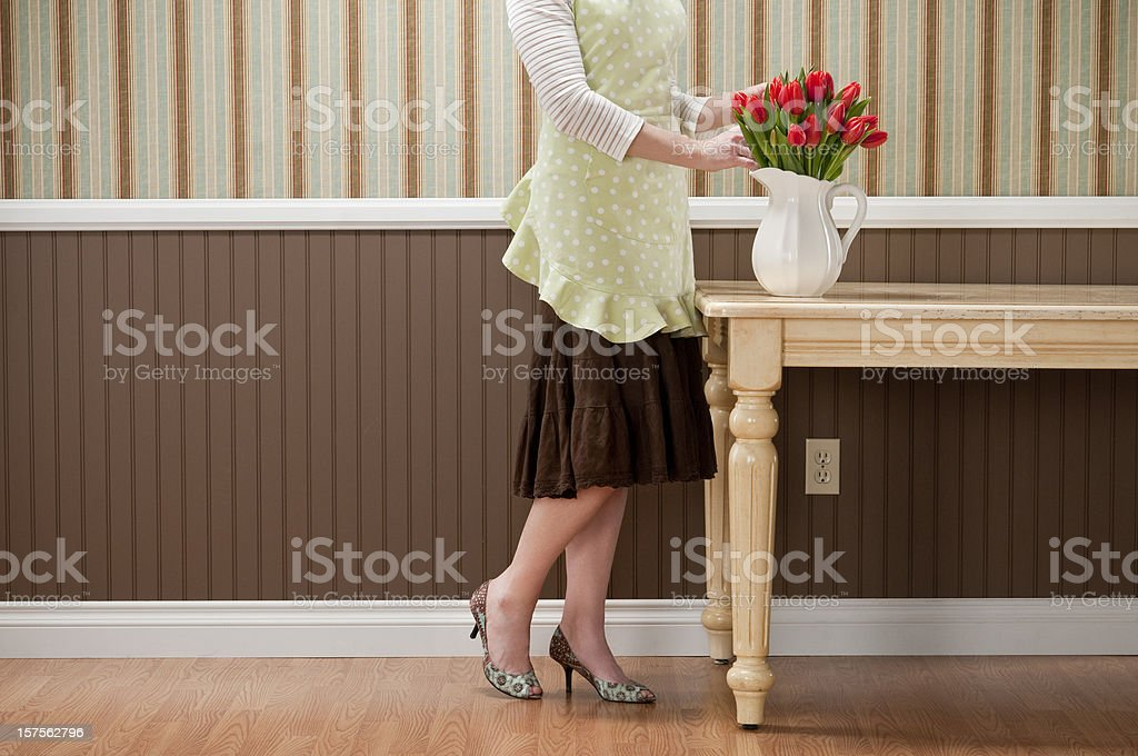 Housewife Arranging Red Tulips royalty-free stock photo