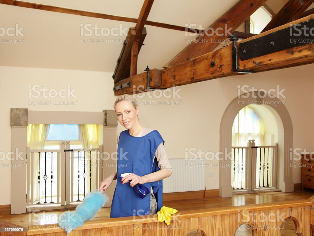 housewife cleaning her bedroom stock photo