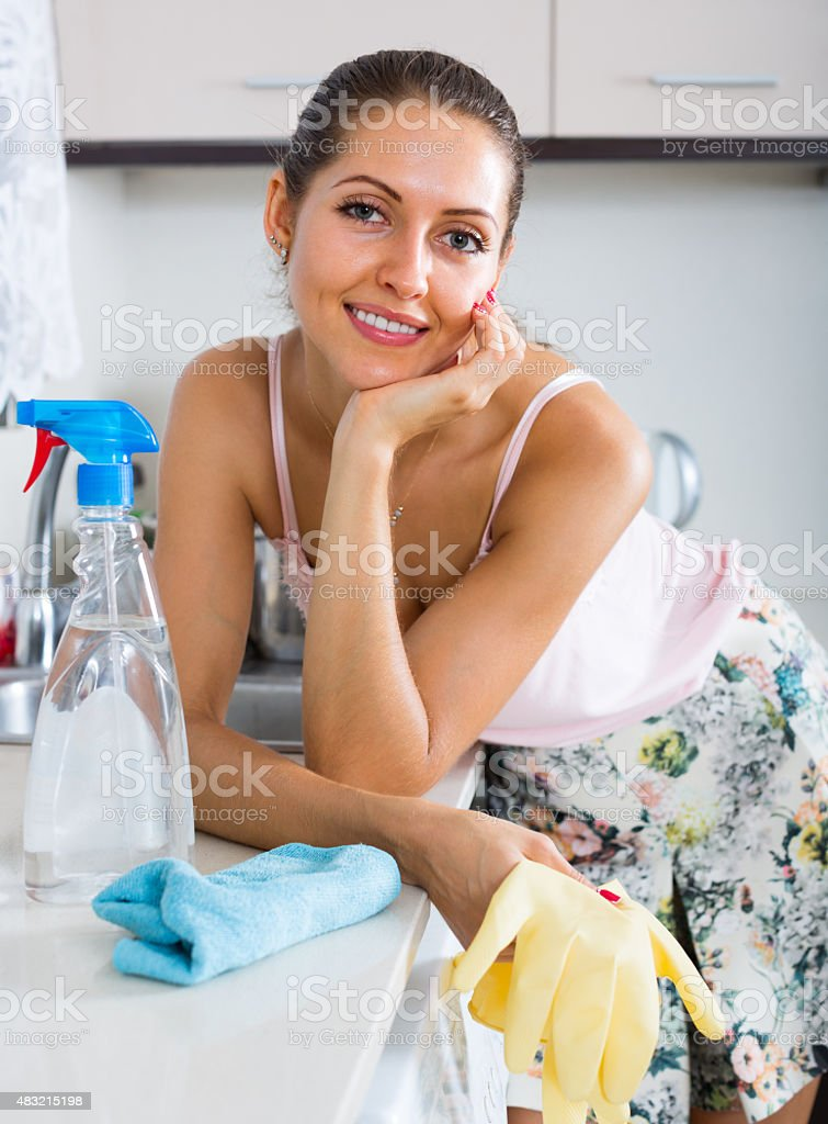 housewife cleaning on the kitchen stock photo