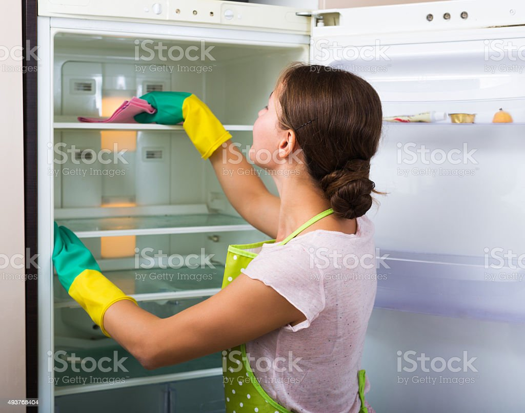 Housewife cleaning refrigerator stock photo