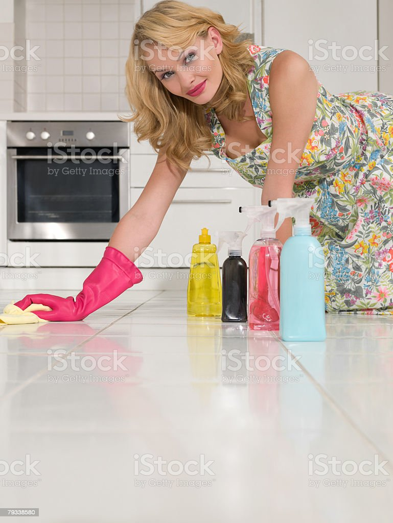 Housewife cleaning the kitchen floor royalty-free stock photo