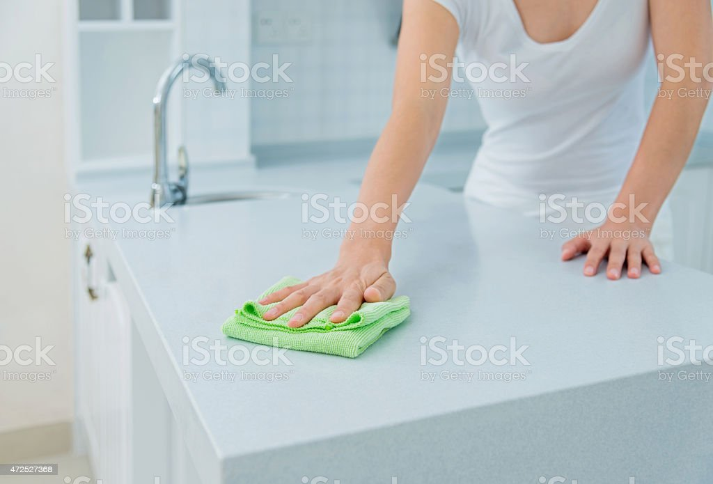 Housewife cleaning the kitchen stock photo