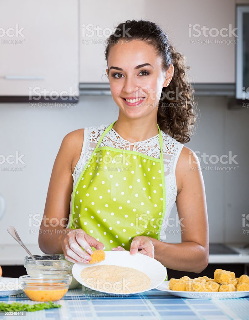 housewife cooking breadcrumbed croquettes stock photo