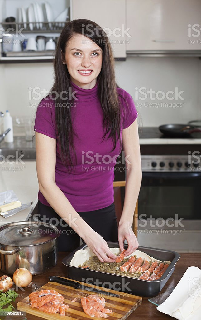 housewife cooking fish pie with  salmon stock photo