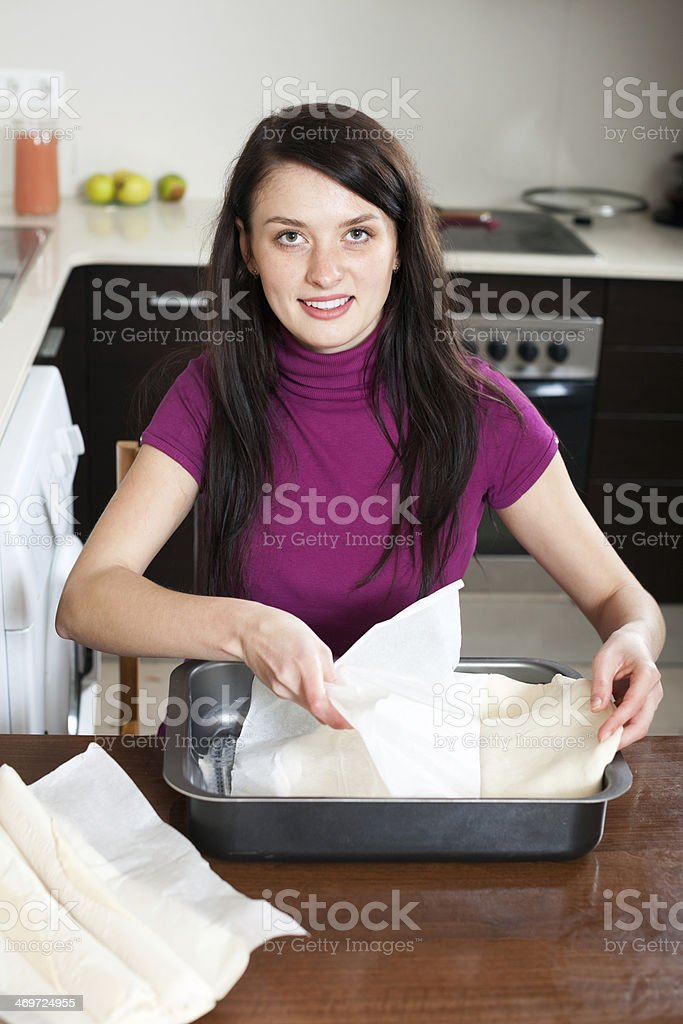 Housewife cooking with store-bought dough stock photo
