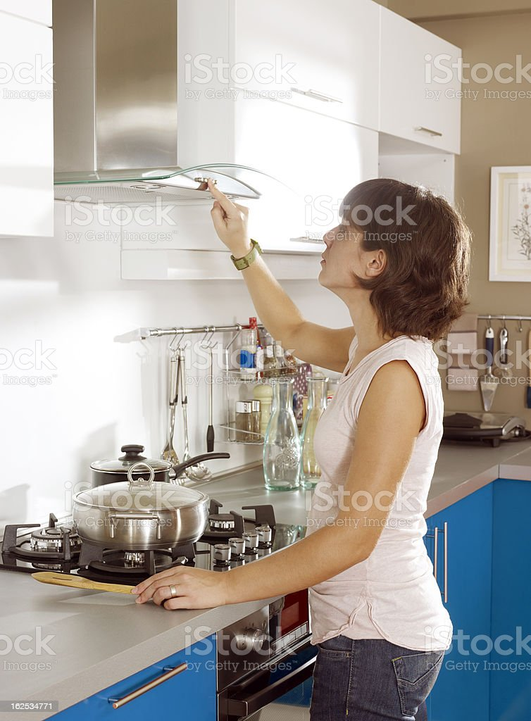 Housewife cooks in the kitchen stock photo