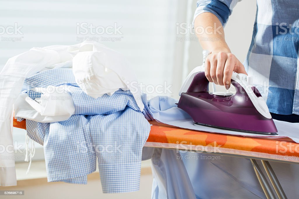 Housewife during ironing at home stock photo