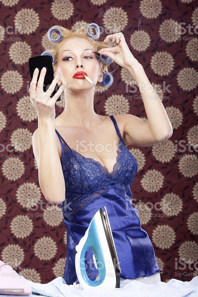 Housewife fixing fake eyelash royalty-free stock photo