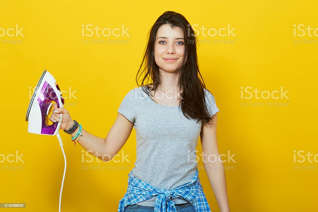 housewife girl with iron in his hand stock photo
