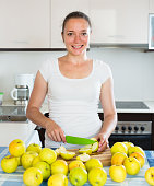 housewife in the kitchen with apples