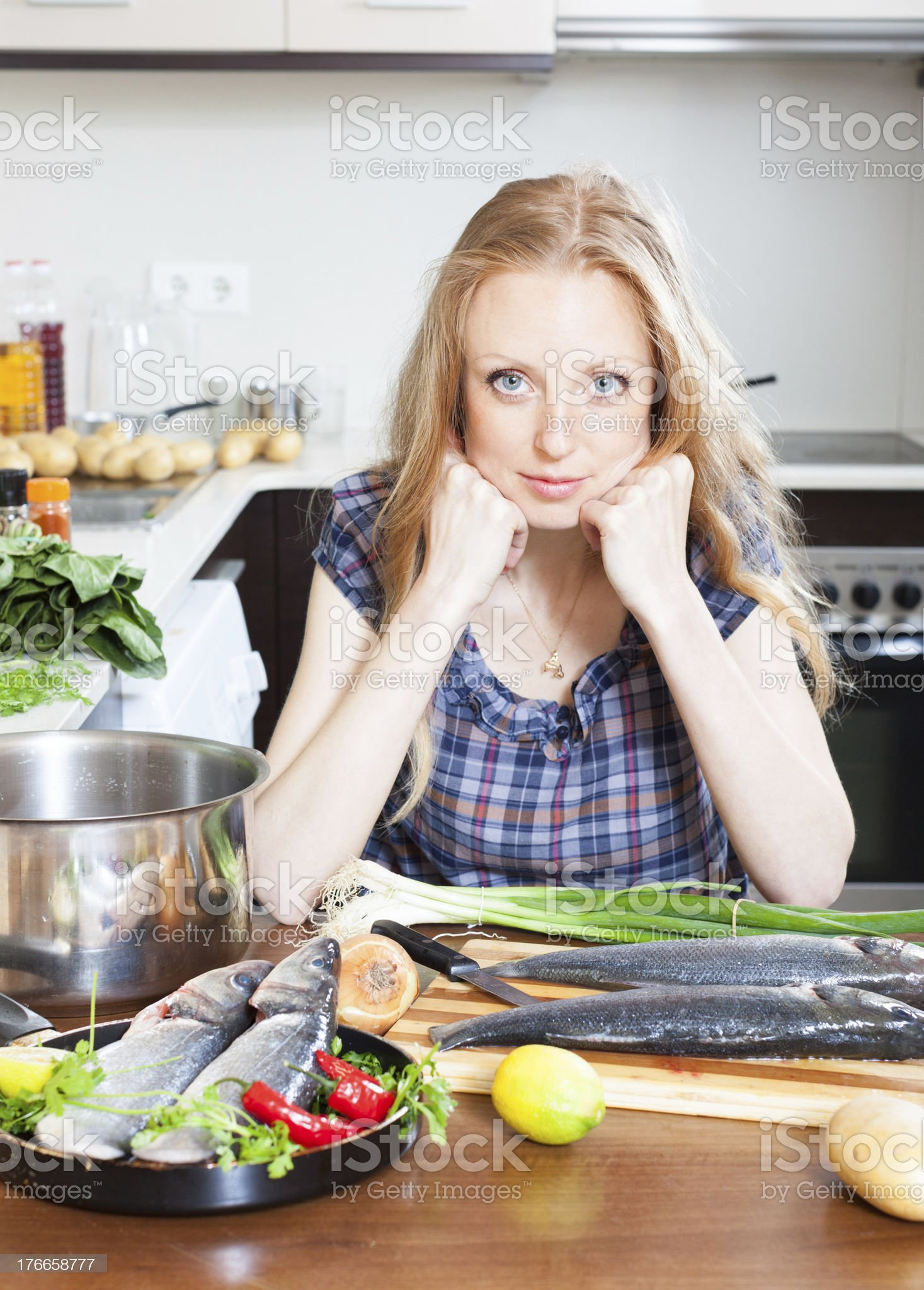 housewife is thinking how to cook seabass royalty-free stock photo