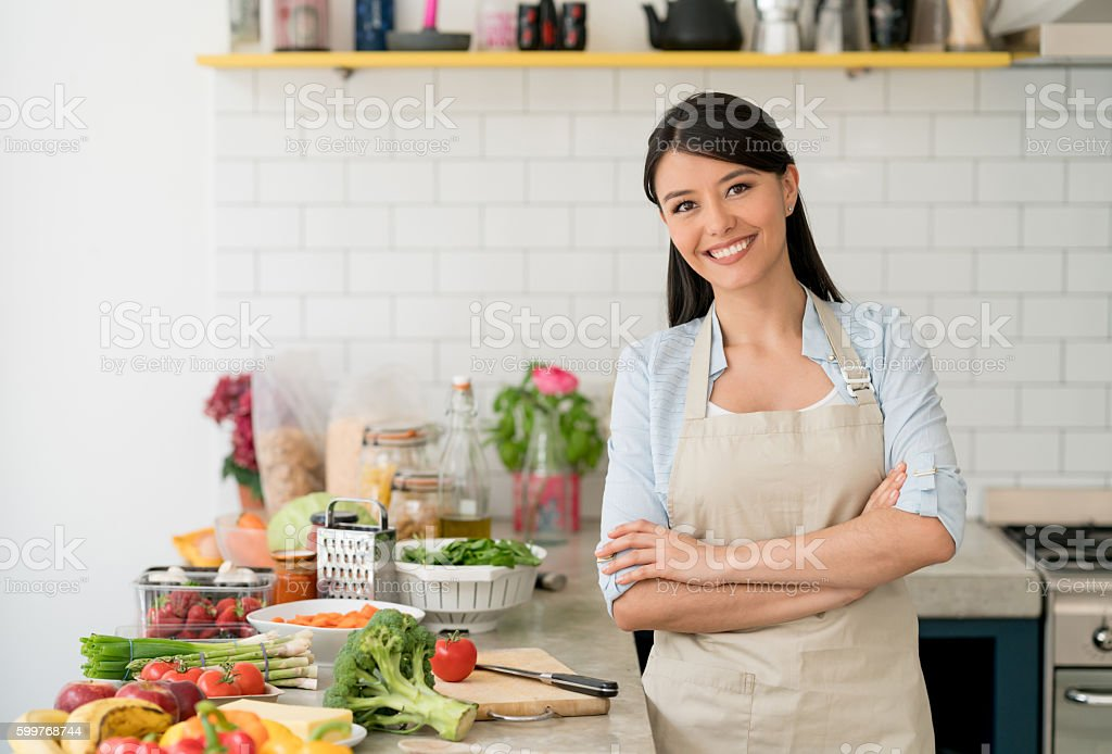 Housewife making dinner at home stock photo