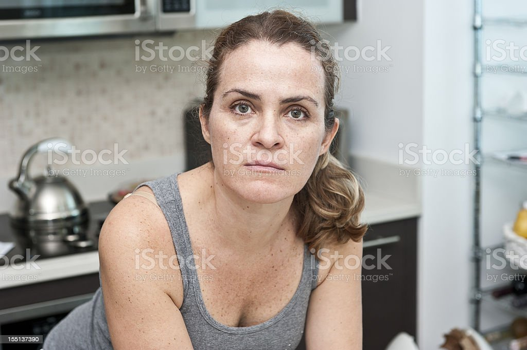 Housewife posing at her kitchen royalty-free stock photo