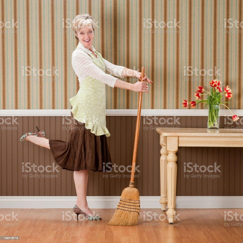 Housewife Posing With Broom stock photo