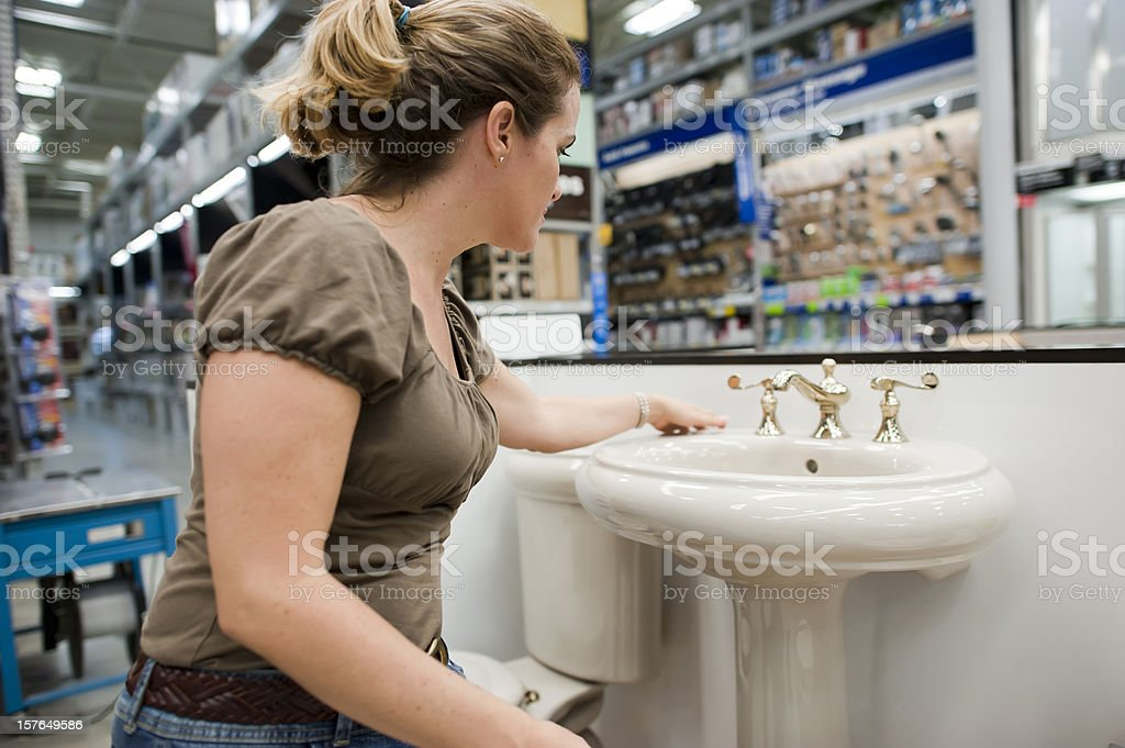 Housewife shopping for a bathroom sink royalty-free stock photo
