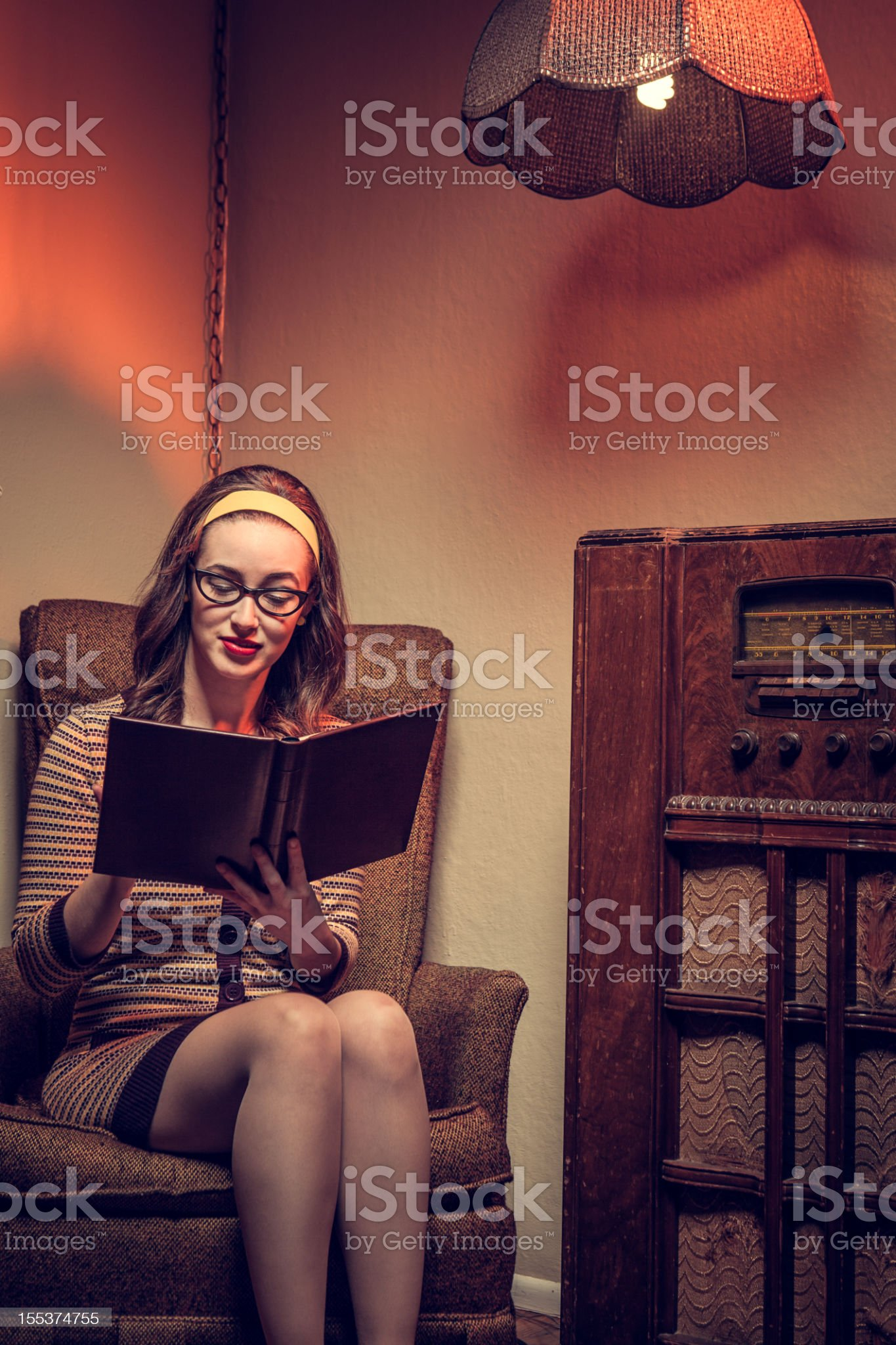 Housewife Sixties Style Reading Book royalty-free stock photo