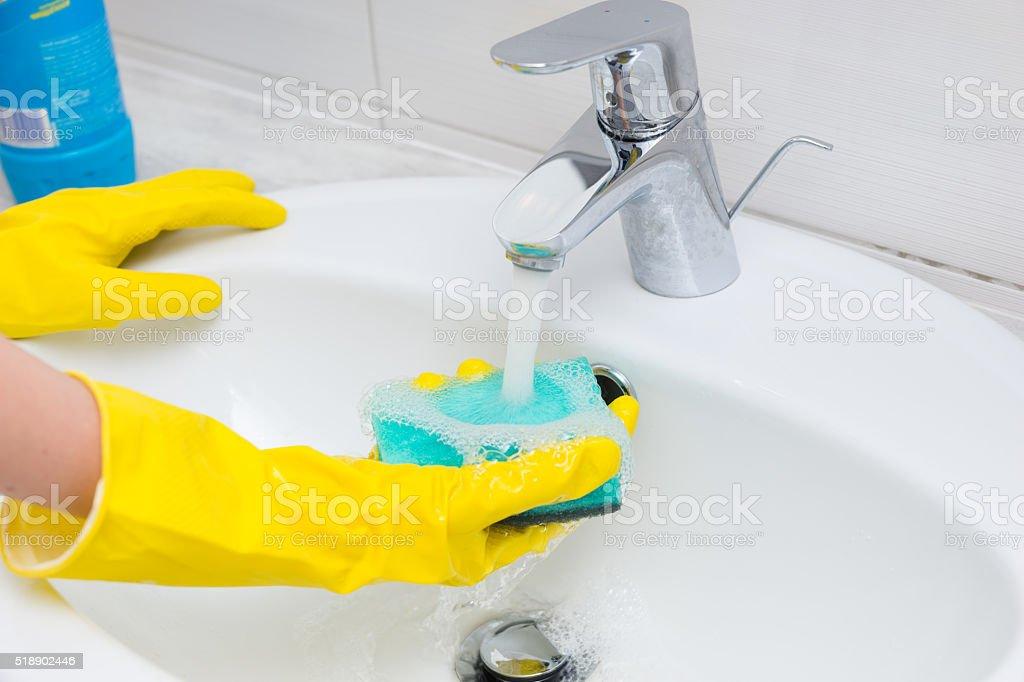Housewife washing  hand basin in the bathroom stock photo