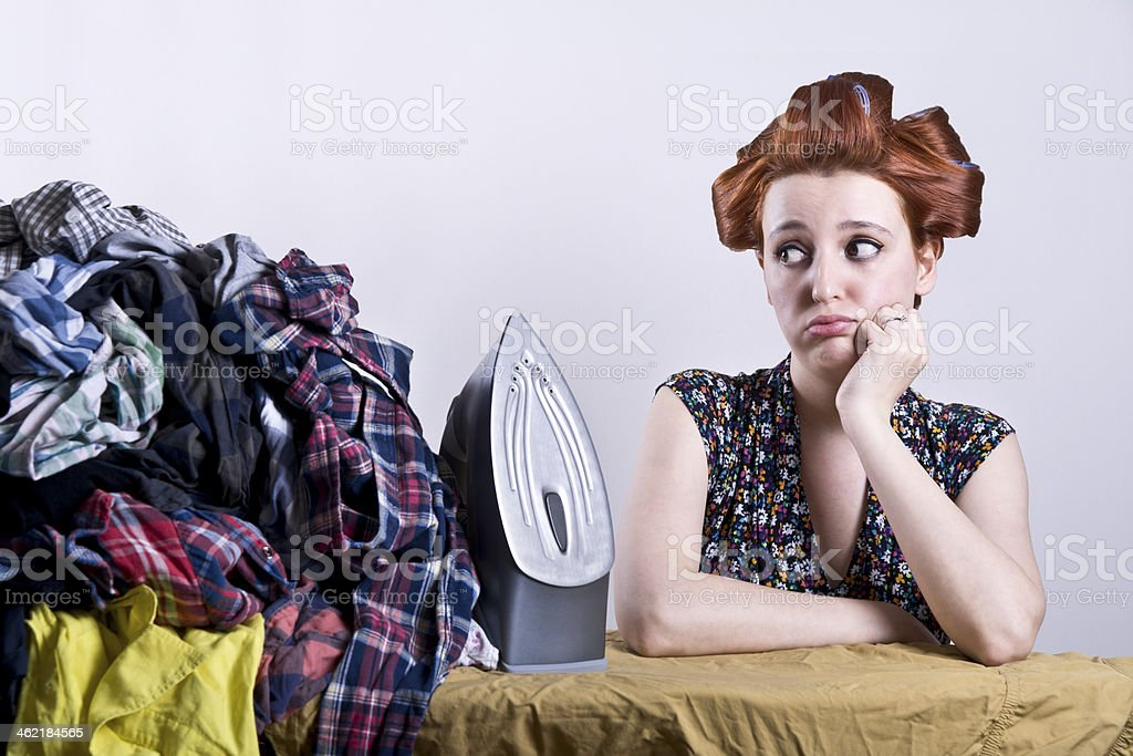 housewife who don't want to do ironing stock photo