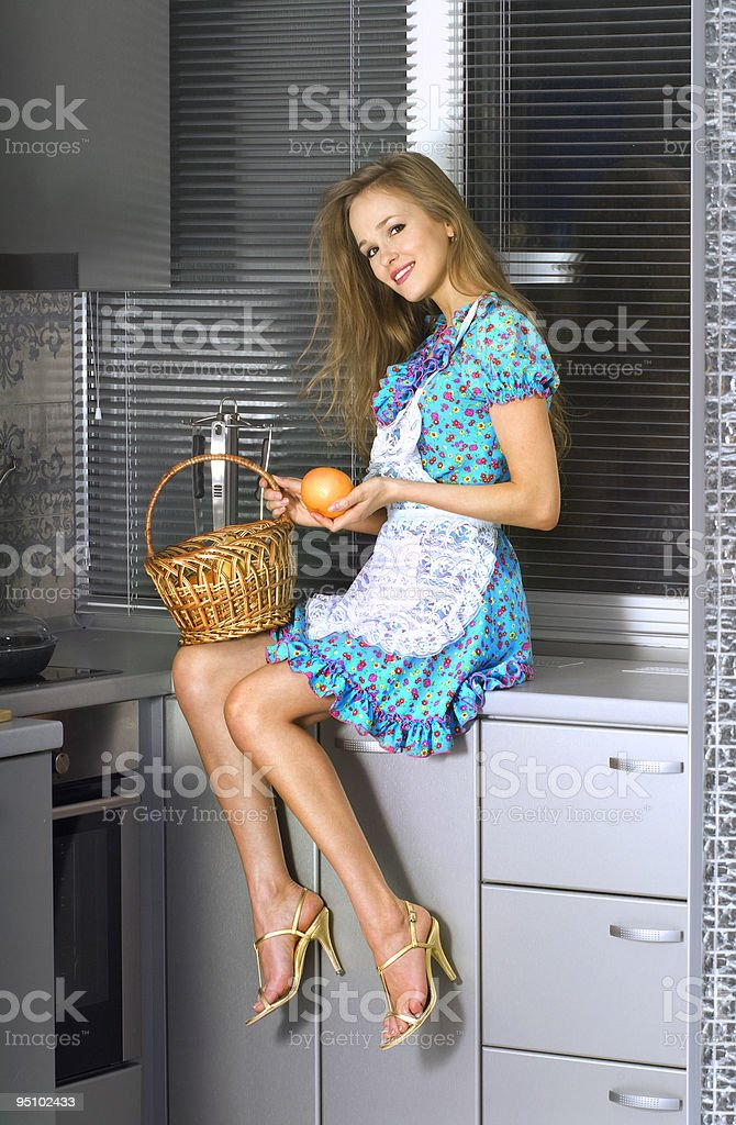 housewife with basket in the kitchen royalty-free stock photo