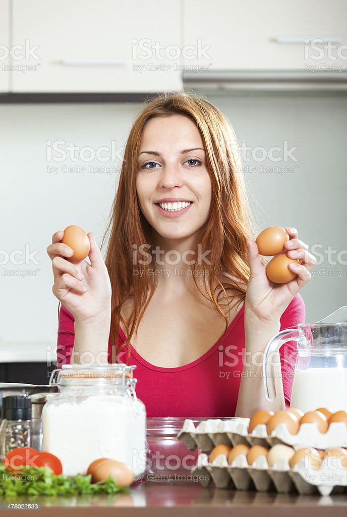 housewife with eggs in home kitchen royalty-free stock photo