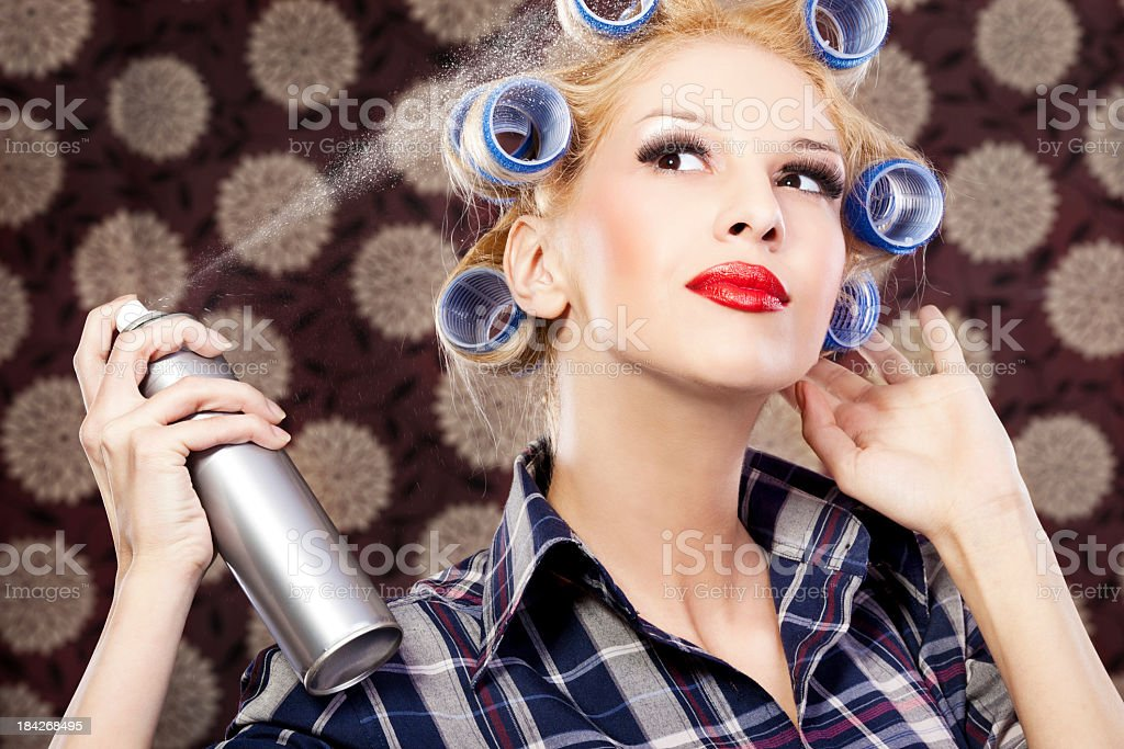Housewife Woman with hair spray stock photo