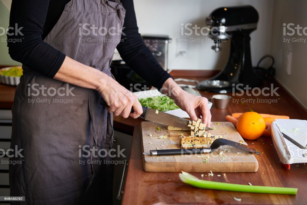 Housewife working in the kitchen stock photo