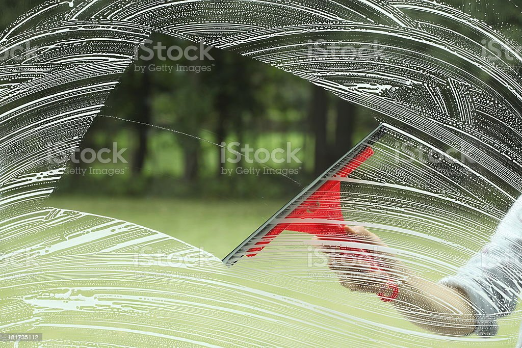 Housework and squeegee for glass stock photo