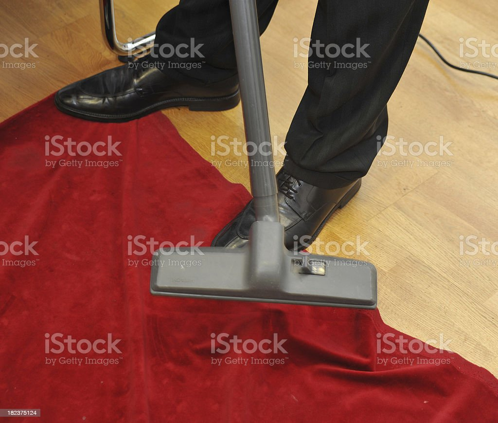 housework cleaning red carpet with vacuum cleaner royalty-free stock photo